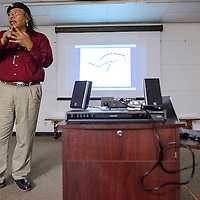 021314       Cable Hoover<br /> <br /> Kenneth Seowtewa explains the history of the Zuni migration during a presentation about Zuni culture at the Octavia Fellin Public Library in Gallup Thursday.
