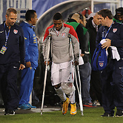 Injured Joseph-Claude Gyau, USA, on crutches after an injury during the USA Vs Ecuador International match at Rentschler Field, Hartford, Connecticut. USA. 10th October 2014. Photo Tim Clayton