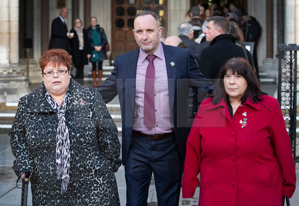 © Licensed to London News Pictures. 11/12/2019. London, UK. Relatives of the victims of the 1982 Hyde Park Bomb, (L-R) SarahJane Young, Mark Tipper and  Judith Jenkins arrive at The High Court where they are bringing a civil case against convicted IRA member John Downey. A previous criminal case against Downey at The Old Bailey collapsed in 2014 after it emerged he had received a so-called 'on the run' letter dating back to 2007 as part of the Good Friday Agreement peace deal. The Hyde Park bombing in July 1982 killed Squadron Quartermaster Corporal Roy Bright, Lieutenant Anthony Daly, Lance Corporal Jeffrey Young and Trooper Simon Tipper. Photo credit: Peter Macdiarmid/LNP