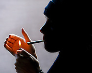 In this photo illustration, a Roaring Fork Valley resident lights up a joint in Aspen, Colorado.