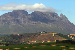 Feb 27, 2006; Stellenbosch SOUTH AFRICA; Vineyards in Stellenbosch, South Africa. Stellenbosch is the capital of the Cape Winelands and was the second town to be founded in South Africa in 1685. A main tourist attraction of the Western Cape, Stellenbosch boosts over 200 estates that offer wine tastings. Exports of South African wines have grown substantially since the end of international sanctions imposed under apartheid (Credit Image: © Krista Kennell/ZUMAPRESS.com)