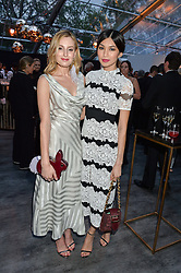 Left to right, LAURA CARMICHAEL and GEMMA CHAN at British Vogue's Centenary Gala Dinner in Kensington Gardens, London on 23rd May 2016.