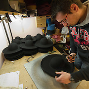 VENICE, ITALY - JANUARY 20:  Hatmaker Alvise of the historic atelier Pietro Longi works on hat for on January 20, 2012 in Venice, Italy. This is one of the busiest periods of the year for the atelier as the next few weeks the streets and canals of Venice will be filled with people attending the carnival,  wearing highly-decorative and imaginative carnival costumes and masks.