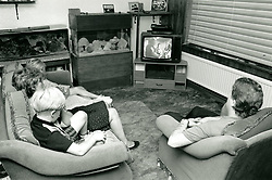Family watching tv, Nottingham UK 1991