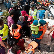 At  the fishing harbour of Skala Sykamias, Lesvos, Greece, minutes after the Portuguese  coast guards towed a boat with around 50 refugees.