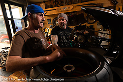 Reini Servello in his shop with a mechanic / friend in Reini's Bobber Garage custom shop in Vaduz, Liechtenstein. (The only custom shop in the country!) Monday, February 25, 2019. Photography ©2019 Michael Lichter.