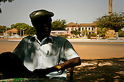 A hot and lazy afternoon in front of the old Presidential Palace, still a wreck since the civil war that hit the country in 1998.