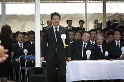 August 9, 2016 - Nagasaki, Nagasaki Prefecture, Japan - NAGASAKI, JAPAN - AUGUST 9 : Japanese Prime Minister Shinzo Abe walks to deliver a speech during the 71st Anniversary of atomic bombing on Nagasaki at Nagasaki Peace Park, Nagasaki, southern Japan, Tuesday, August 9, 2016. Japan marked the 71st anniversary of the atomic bombing on Nagasaki. On August 9, 1945, during World War II, the United States dropped the second Atomic bomb on Nagasaki city, killing an estimated 40,000 people which ended World War II. (Credit Image: © Richard Atrero De Guzman/NurPhoto via ZUMA Press)