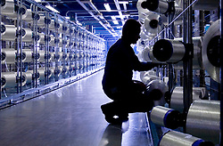 Photographed for Performance Fibers Annual Report and Promotional Campaign:<br /> <br /> An employee works in the Fibers Department at the Performance Fibers plant in Longlaville, France.
