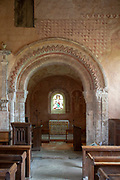 Medieval frescoes church of Saint Mary, Kempley, Gloucestershire, England, UK - Norman chancel arch