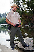 Fernando Gomez, Chief Ranger for the MRCA (Mountains, Recreation and Conservation Authority). Raphael Sbarge films FoLAR documentary along banks of Los Angeles River, Glendale Narrows, Los Angeles, California, USA