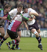 Twickenham, England, The Stoop, Surrey.<br /> 25/10/2003 - Photo  Peter Spurrier<br /> 2003_04 Zurich Premiership Rugby - Harlequins v Sale Sharks<br /> Sale's Chris Jones is tackled by James Hayter.