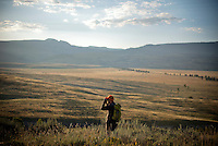 A hunter scans the hillsides of the north end of the National Elk Refuge during opening day of bison hunting Saturday morning.
