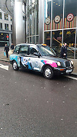 London cab wrap with photo by ©Carol Grant of manatee and Meredith