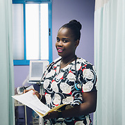 INDIVIDUAL(S) PHOTOGRAPHED: Narcisse Sandia. LOCATION: Justinian University Hospital (HUJ), Cap-Haïtien, Haïti. CAPTION: Student nurse Narcisse Sandia poses for a portrait in the Critical Care Unit of the Justinian University Hospital (HUJ) in Cap-Haïtien.