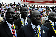 Guests watch the procession at the official independence day ceremony. After decades of conflict, Southern Sudan declared independence from the North on July 9th, 2011. Government officials, foreign dignitaries and ordinary people came to the John Garang Memorial in the capital from all over the country and the world to celebrate the historic occation..Juba, South Sudan. 09/07/2011..Photo © J.B. Russell
