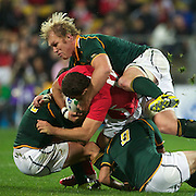 Schalk Burger, South Africa, (top) assists team mates in tackling Jamie Roberts, Wales, during the Wales V South Africa, Pool D match during the Rugby World Cup in Wellington, New Zealand,. 11th September 2011. Photo Tim Clayton