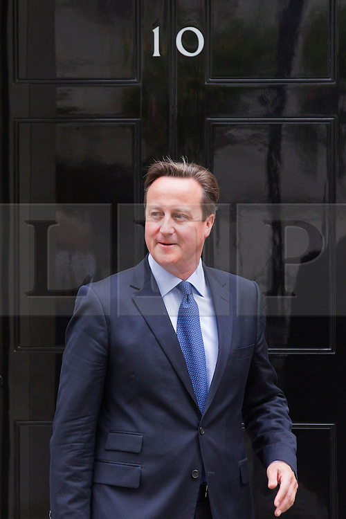 © Licensed to London News Pictures. 17/09/2013. London, UK. The British Prime Minister David Cameron exits Number 10 Downing Street to meet with the Libyan Prime Minister Ali Zeidan in London today (17/09/2013). Photo credit: Matt Cetti-Roberts/LNP