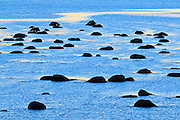 Rockes in Gulf of St. Lawrence at dusk<br /> Baie Comeau<br /> Quebec<br /> Canada
