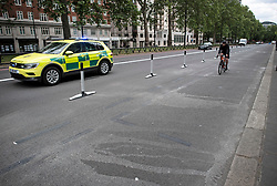 © Licensed to London News Pictures. 16/05/2020. London, UK. A new cycle lane on Park Lane in London which has been widened to accommodate more cyclists, reducing traffic to one normal lane and a bus lane. Government has announced a series of measures to slowly ease lockdown, which was introduced to fight the spread of the COVID-19 strain of coronavirus. Photo credit: Ben Cawthra/LNP