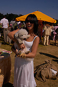 Rosey Chan and Boby. Veuve Clicquot Gold Cup Final at Cowdray Park. Midhurst. 17 July 2005. ONE TIME USE ONLY - DO NOT ARCHIVE  © Copyright Photograph by Dafydd Jones 66 Stockwell Park Rd. London SW9 0DA Tel 020 7733 0108 www.dafjones.com