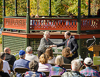 Belmont Heritage Chairman Linda Frawley thanks James Garvin PSU Faculty/retired State Architectural Historian after his speech during the Community Salute at the historic Belmont Bandstand Sunday afternoon.  (Karen Bobotas/for the Laconia Daily Sun)