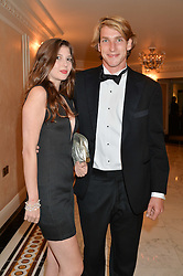 FREDDIE HUNT son of the late F1 World Champion James Hunt and MISS ISABEL SIDOROINICZ at the David Shepherd Wildlife Foundation 30th anniversary Wildlife Ball at The Dorchester, Park Lane, London on 10th October 2014.