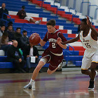 (Photograph by Bill Gerth for SVCN) Cupertino #2 George Ellegood drives to the hoop vs. Mission San Francisco boys basketball in the Fukushima Basketball Tournament at Independence High School, San Jose CA on 12/7/16.  (Mission San Francisco 52 Cupertino 47)