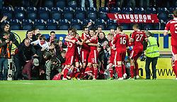 Aberdeen's Vernon celebrates with team mates after after scoring their fifth goal, and the fans cause the boards to fall. Falkirk 0 v 5 Aberdeen, the third round of the Scottish League Cup.<br /> ©Michael Schofield.
