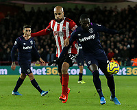 Sheffield United's David McGoldrick battles with West Ham United's Arthur Masuaku <br /> <br /> Photographer Rich Linley/CameraSport<br /> <br /> The Premier League - Sheffield United v West Ham United - Friday 10th January 2020 - Bramall Lane - Sheffield <br /> <br /> World Copyright © 2020 CameraSport. All rights reserved. 43 Linden Ave. Countesthorpe. Leicester. England. LE8 5PG - Tel: +44 (0) 116 277 4147 - admin@camerasport.com - www.camerasport.com