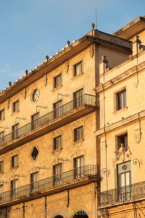 Building exterior with balcony and windows, Havana, Cuba