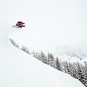 Jim Ryan grabs some air in blower powder winter storm in the Teton backcountry.