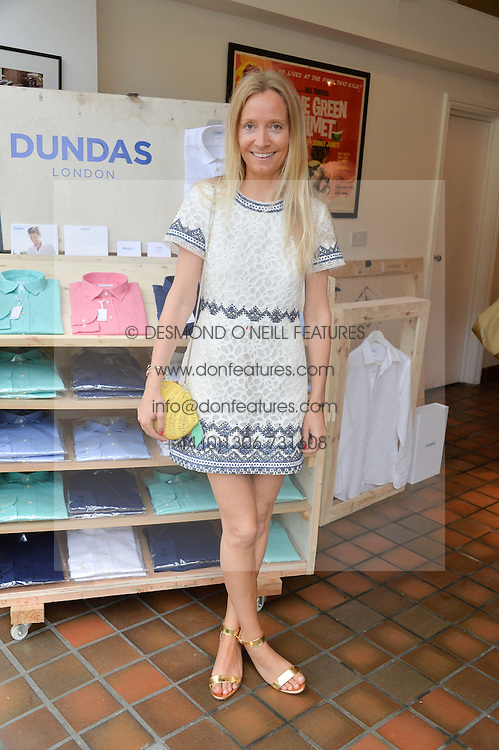 MARTHA WARD at the launch of Dundas London held at Fiskins Classic Car Showroom, 14 Queens Gate Place Mews, London on 25th June 2014.