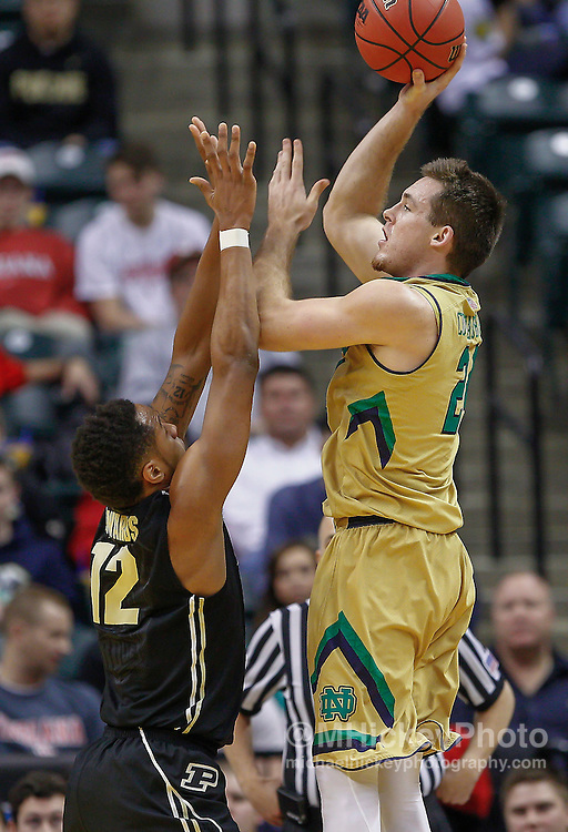 INDIANAPOLIS, IN - DECEMBER  20: Pat Connaughton #24 of the Notre Dame Fighting Irish shoots the ball against Vince Edwards #12 of the Purdue Boilermakers at Bankers Life Fieldhouse on December 20, 2014 in Indianapolis, Indiana. Notre Dame defeated Purdue 94-63. (Photo by Michael Hickey/Getty Images) *** Local Caption *** Pat Connaughton; Vince Edwards