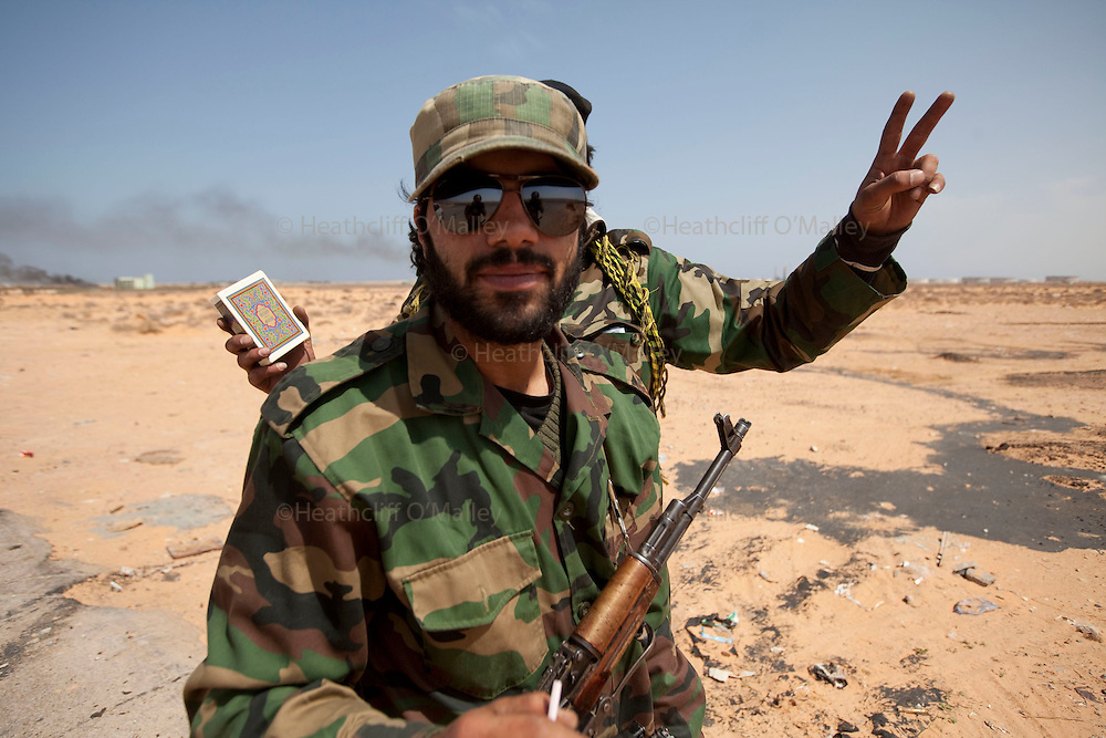 Mcc0030300 . Daily Telegraph..Libyan rebel fighters in the wealthy oil town of Ras Lanuf, which Libyan government forces retreated from last night..Gaddafi's have been on forced retreat since saturday night due to repeated attacks from NATO airstrikes...Ras Lanuf 27 March 2011