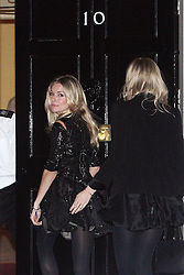 ©London News pictures. 21.02.2011. Sienna Miller is patted on the bottom by a friend as she enters an event at No 10 Downing Street hosted by Prime Minister's wife Samantha Cameron to celebrate the UK's fashion industry. Picture Credit should read Carmen Valino/LNP
