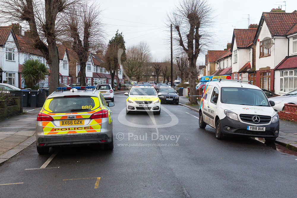 Police guard the scene on St Joseph's Road in Enfield, North London where a man was shot and died at the scene on the evening of December 18th . London, December 19 2018.