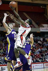 "09 January 2007: Keith ""Boo"" Richardson takes a left hander, knocking Grant Stout and Brooks McKowen from his path. The Illinois State Redbirds, winless in the Missouri Valley Conference, knocked off the undefeated  Panthers of Northern Iowa 67-64 in overtime at Redbird Arena in Normal Illinois on the campus of Illinois State University.<br />"