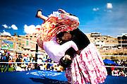 Abril y Mayo 2011/Bolivia<br /> Carmen Rosa La Luchadora de Camisa Negra levanta a su rival Julia La Paceña en la lucha por el titulo de Bolivia en la localidad de Yojeta Central <br /> <br /> Foto:Juan Gonzalez