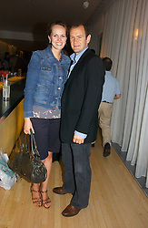 Actor XANDER ARMSTRONG and his wife HANNAH at a party to celebrate the launch of Amy Sacco's book 'Cocktails' held at Sanderson, 50 Berners Street, London W1 on 10th July 2006.<br />
