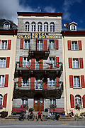 Touring cyclist waits for check-in at boutique hotel after a long day climbing through the Alps - Switzerland