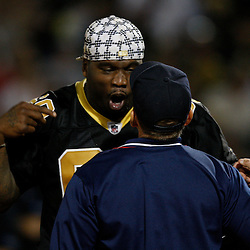 Apr 28, 2010; Metairie, LA, USA; Anthony Hargrove (69) has a mock argument with the home plate umpire during the Heath Evans Foundation charity softball featuring teammates of the Super Bowl XLIV Champion New Orleans Saints at Zephyrs Field.  Mandatory Credit: Derick E. Hingle-US-PRESSWIRE.