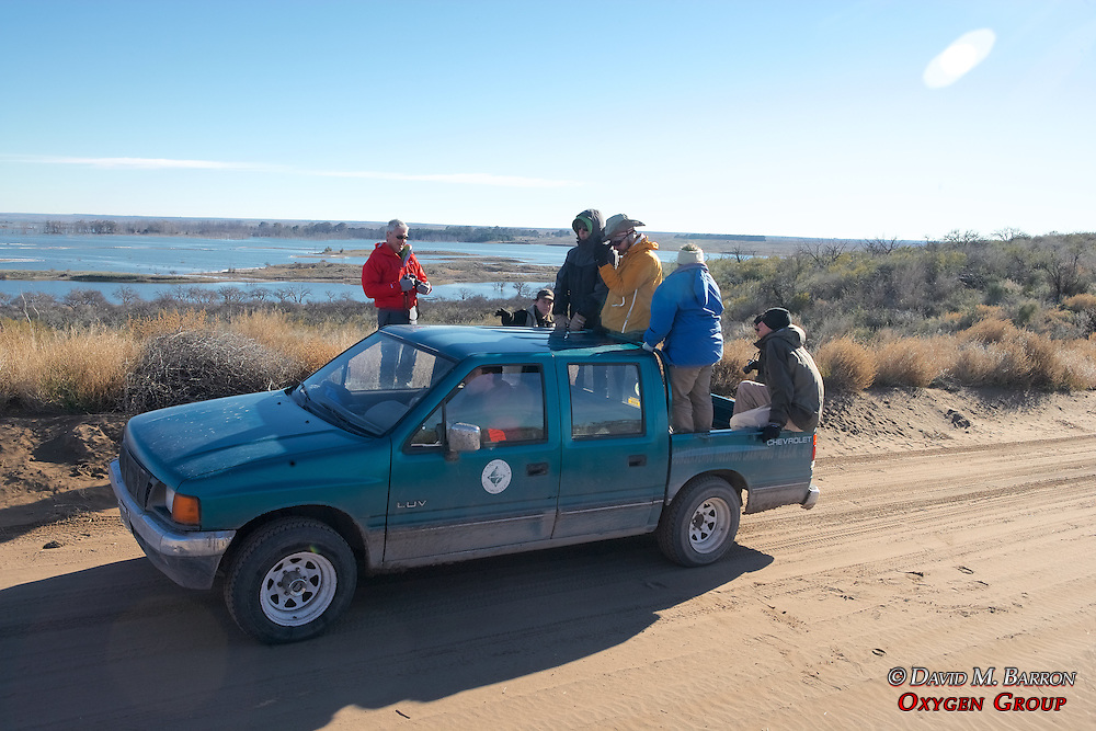 Earthwatch Team Checking Tracks