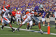 MANHATTAN, KS - SEPTEMBER 27:  Quarterback Josh Freeman #1 of the Kansas State Wildcats scores on a 15 yard touchdown run in the second quarter past defenders Scooter Rogers #13 and Jezreel Washington #53 of the Louisiana-Lafayette Ragin' Cajuns on September 27, 2008 at Bill Snyder Family Stadium in Manhattan, Kansas.  Kansas State defeated Louisiana-Lafayette 45-37.