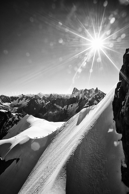 The black and white view from Aiguille du Midi overlooking the French Alps - Chamonix, France (Vertical).