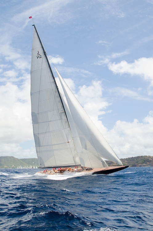 """J H2.<br /> <br /> Back in the 60s, classic yachts, which were gathered in English Harbour Antigua, had begun chartering and the captains and crews challenged each other to a race down to Guadeloupe and back to celebrate the end of the charter season. From this informal race, Antigua Race Week was formalised in 1967, and in those days all of the yachts were classics. As the years grew on, the classic yachts were slowly outnumbered but the faster sleeker modern racing yachts and 24 years later the Classic Class had diminished to a few boats and was abandoned in 1987. However this same year seven classic yachts turned out and were placed in Cruising Class 3 with the bare boats. The class was so unmatched that it was downright dangerous, so Captain Uli Pruesse hosted a meeting onboard Aschanti of Saba with several classic skippers and in 1988 the Antigua Classic Yacht Regatta was born, with seven boats.<br /> <br /> In 1991, Elizabeth Meyer brought her newly refitted Endeavour and Baron Edmond Rothschild brought his 6-meter Spirit of St Kitts and """"CSR"""" became the first Sponsor and inaugurated the Concours d'Elégance. In 1996 we created the """"Spirit of Tradition Class"""", which has now been accepted all over the world, which gives the """"new"""" classics, built along the lines of the old, a chance to sail alongside their sister ships. In 1999 we celebrated the first race between the J class yachts in 60 years. Mount Gay Rum has sponsored the Regatta for many years, and we have recently added Officine Panerai as our first ever Platinum Sponsor.<br /> <br /> The Antigua Classic Yacht Regatta has maintained a steady growth, hosting between 50 and 60 yachts every year and enjoys a wonderful variety of competitors, including traditional craft from the islands, classic ketches, sloops, schooners and yawls making the bulk of the fleet, together with the stunningly beautiful Spirit of Tradition yachts, J Class yachts and Tall Ships."""