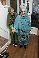 South Asian woman helping her mother .