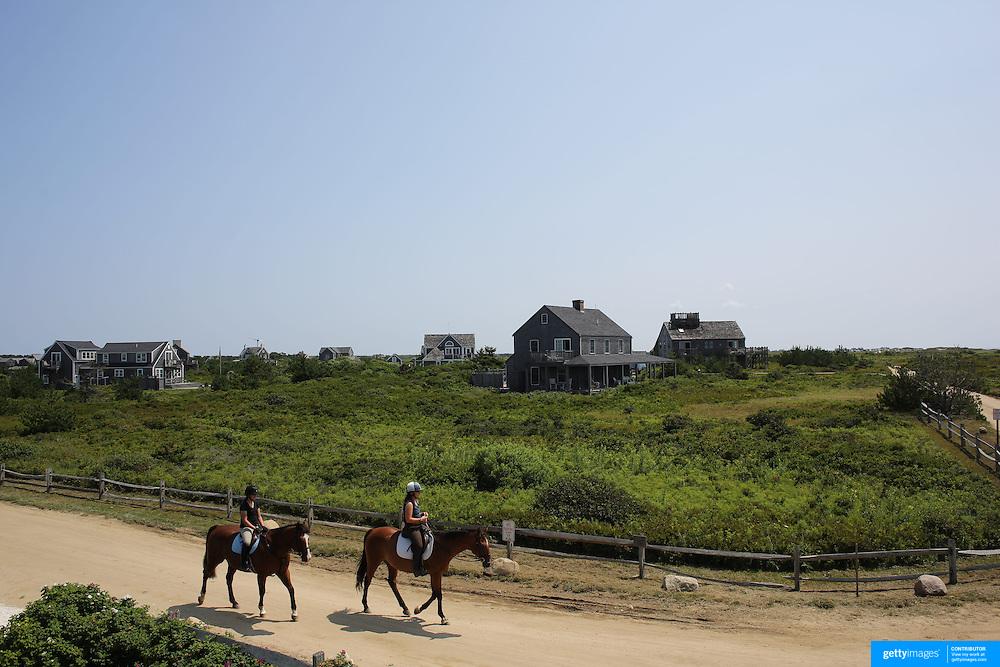 Horse riders head along a track near Cisco Beach, Nantucket, Nantucket Island, Massachusetts, USA. Photo Tim Clayton