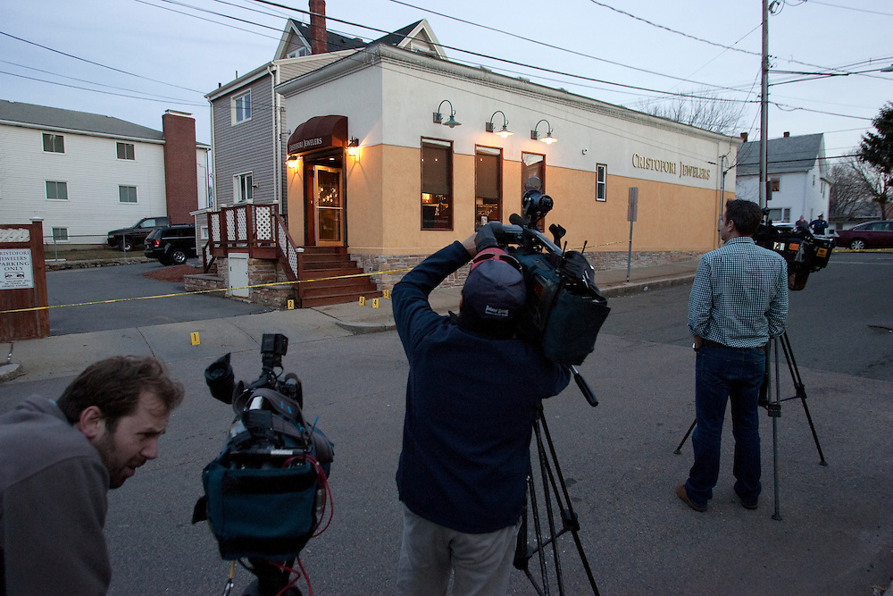 Newton, MA 03/17/2011.News photographers record the scene after an assailant fired 8 shots through the front door of Cristofori Jewelers in Newton on Thursday afternoon..Alex Jones / For The Newton TAB