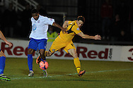 Conor Washington of Newport ® is tackled by Ryan Peters of Braintree. FA cup with Budweiser, 1st round replay, Newport county v Braintree Town at Rodney Parade in Newport, South Wales on Tuesday 19th November 2013. pic by Andrew Orchard, Andrew Orchard sports photography,